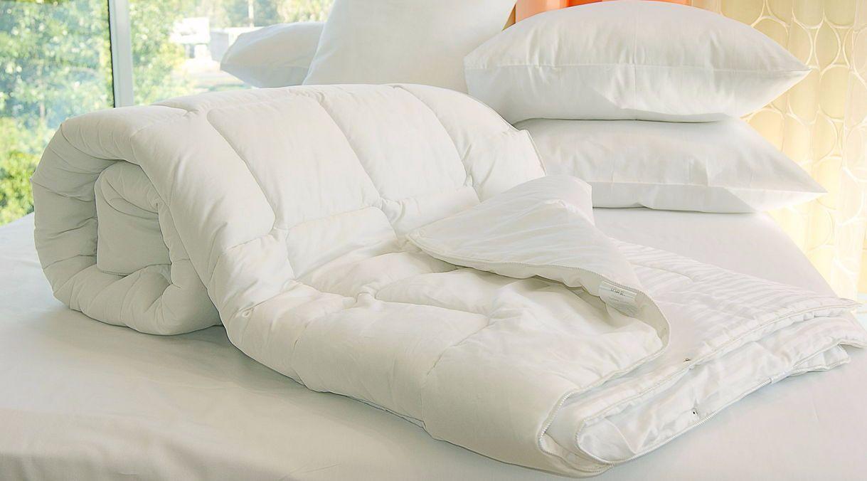 Пуховое одеяло и подушки