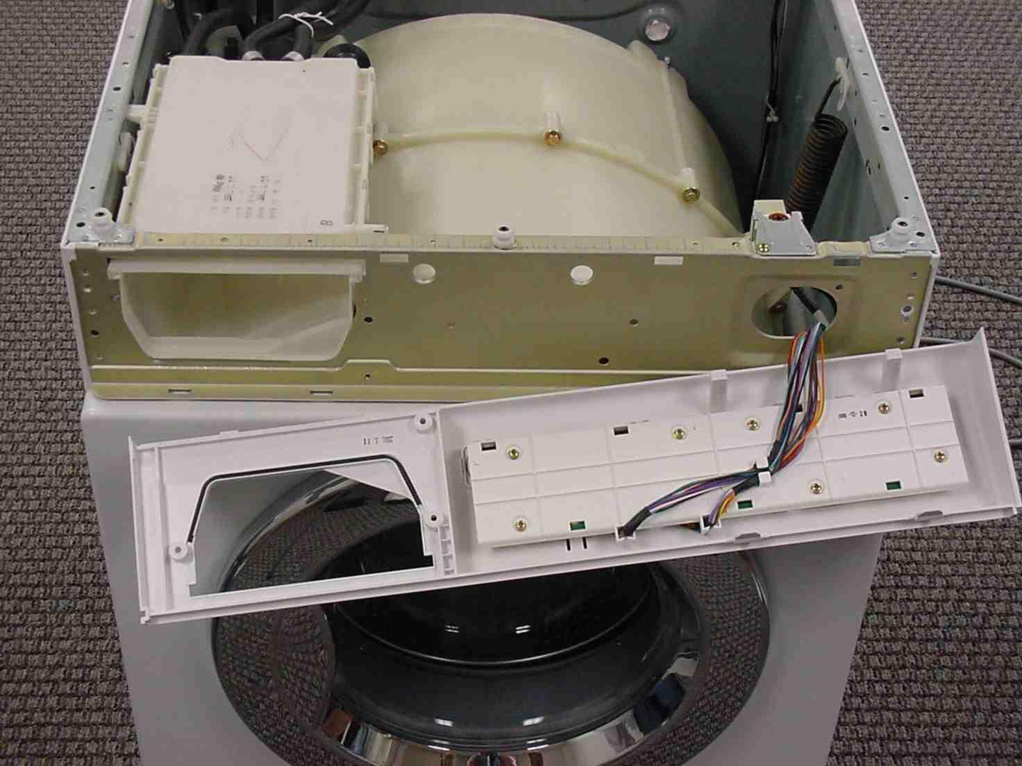 Демонтаж верхней крышки и панели управления СМА