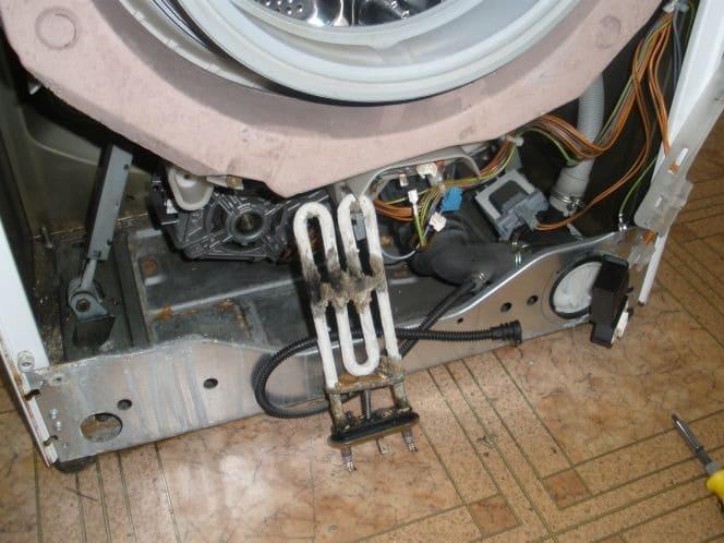 Изношенный ТЭН стиральной машины
