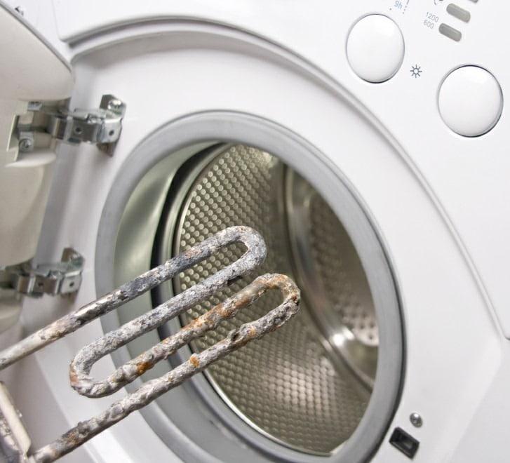 ТЭН стиральной машины покрытый накипью