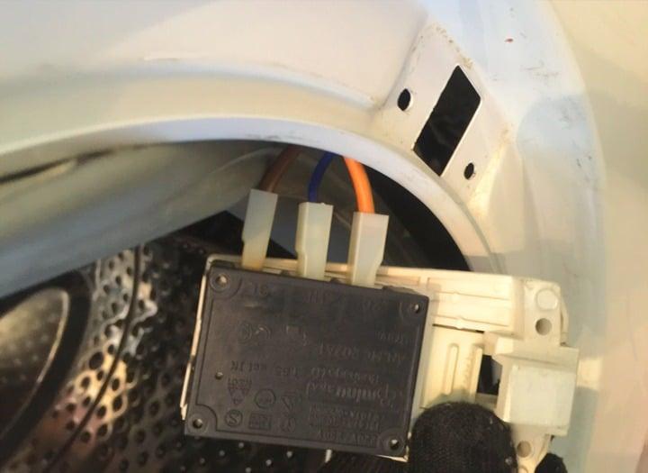 Устройство блокировки люка стиральной машины