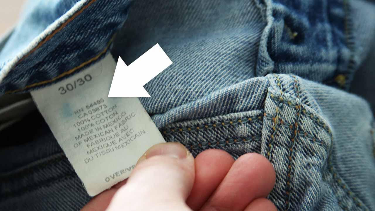 Бирка с допустимыми режимами стирки джинсовой одежды