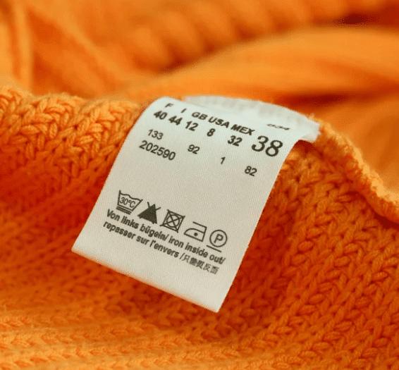 Бирка с условиями стирки одежды