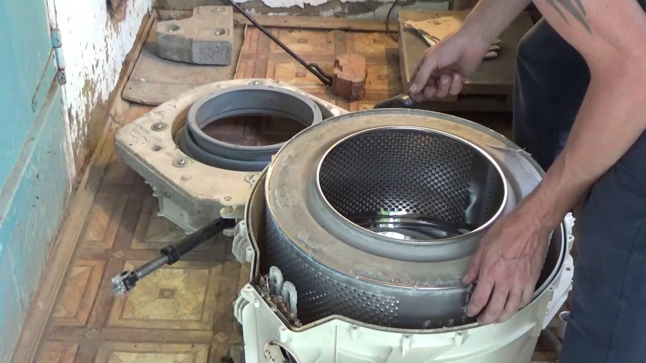 Выемка барабана из бака